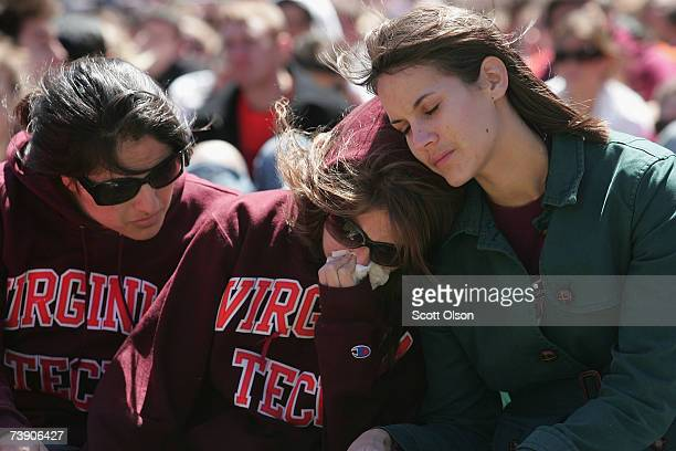 Virginia Tech students comfort each other on the field of the football stadium at a memorial service to honor those killed in yesterday's shootings...