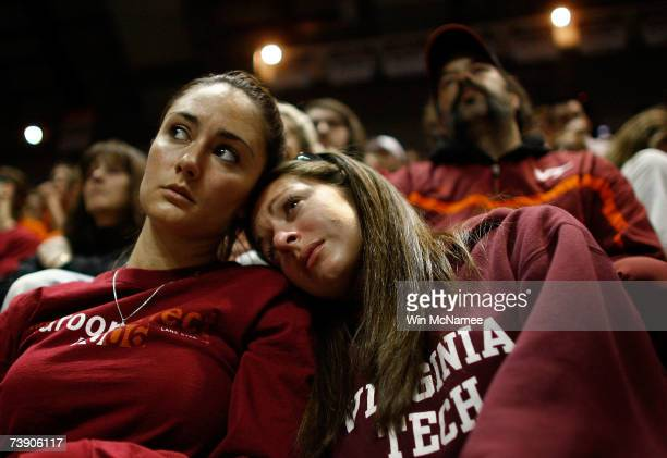 Virginia Tech students comfort one another during a convocation ceremony at Cassell Coliseum a day after a gunman shot and killed 32 people before...