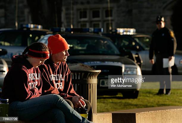 Virginia Tech students Elizabeth Strawn and Jeff Graham sit outside Norris Hall site of yesterday's mass killings on the Virginia Tech campus April...