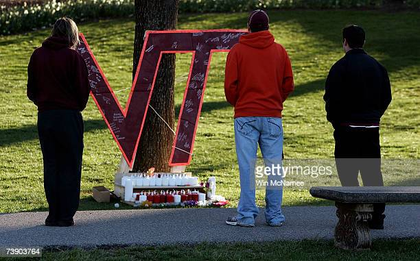 Virginia Tech students gather near a memorial constructed on the Virginia Tech campus for the victims of yesterday's mass killings April 17 2007 in...