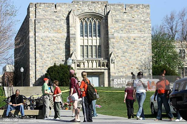 Virginia Tech students gather outside Norris Hall still surrounded by crime scene tape and police vehicles April 23 2007 in Blacksburg Virginia...