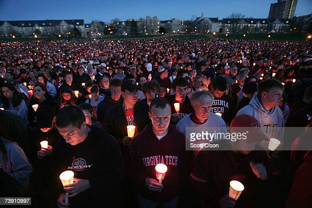 Virginia Tech students their friends and families gather on campus for a candlelight vigil to honor those killed in yesterday's shootings April 17...