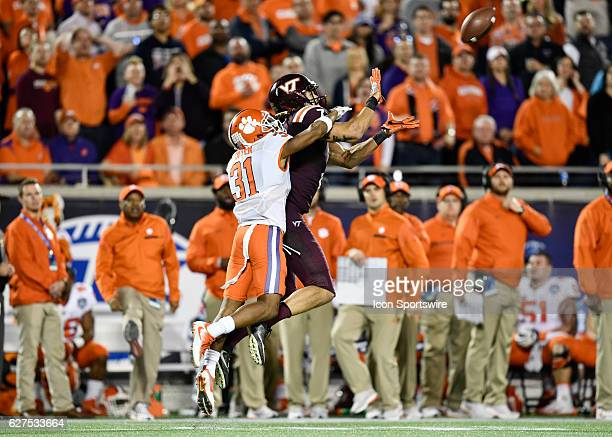 Virginia Tech University tight end Bucky Hodges makes a catch while defended by Clemson University defensive back Ryan Carter during the ACC...