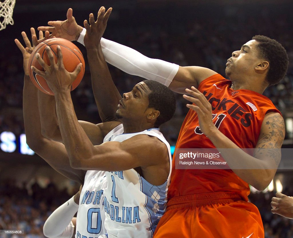 Virginia Tech's Jarell Eddie, right, defends North Carolina's Dexter Strickland during the second half at the Smith Center in Chapel Hill, North Carolina, Saturday, February 2, 2013. North Carolina won in OT, 72-60.
