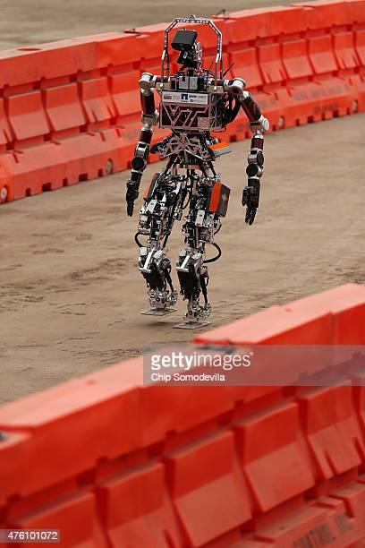 Virginia Tech's Team Valor semiautonomous ESCHER robot walks through the 'slalom' task during the second day of the Defense Advanced Research...