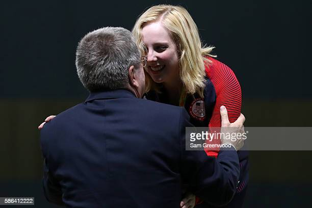 Virginia Thrasher of the United States is given her gold medal by IOC President Thomas Bach after winning the 10m Air Rifle Women's Finals on Day 1...