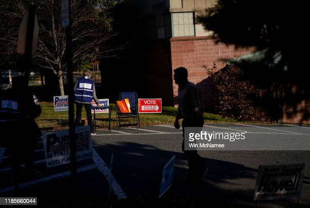 Virginia voters exit a polling station at Nottingham Elementary School November 5 2019 in Arlington Virginia All 140 seats in the General Assembly...