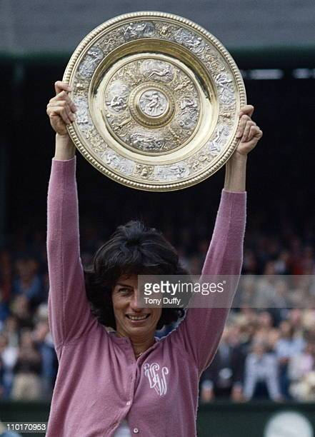 Virginia Wade of Great Britain holds aloft the Venus Rosewater Dish after defeating Betty Stove 4–6 6–3 6–1 in their Women's Singles Final match at...