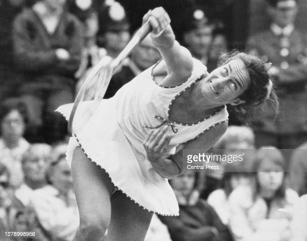 Virginia Wade of Great Britain serves to Billie Jean King of the United States during their Women's Singles Quarter Final match at the Wimbledon Lawn...