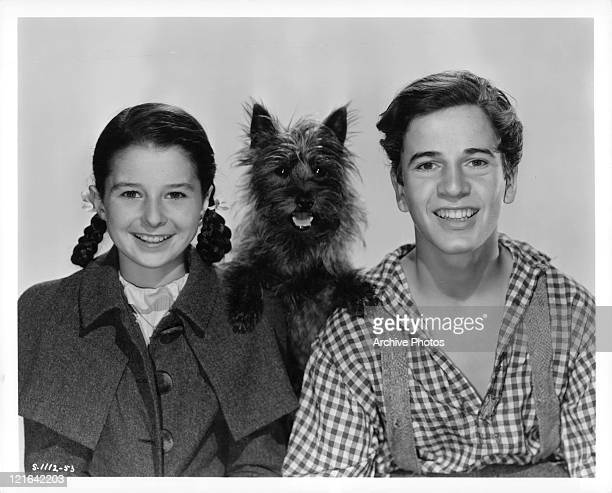Virginia Weidler dog Toto and Gene Reynolds photographed together in a scene from the film 'Bad Little Angel' 1939