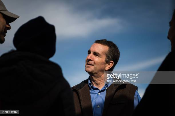 Virginia's Democratic gubernatorial candidate Ralph Northam speaks to people during a campaign stop at Burke Farmer's Market on Saturday November 4...