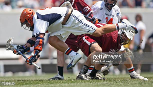 Virginia's Drew Thompson gets tripped up during a faceoff in the Division I Lacrosse Finals Sunday, May 28, 2006 at Lincoln Financial Field in...