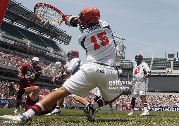 Virginia's goalie Kip Turner tries to make a save during the Division I Lacrosse Finals between University of Massachusetts and the University of...