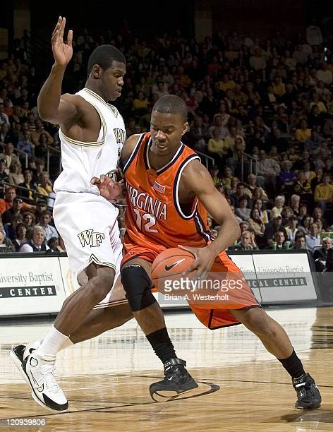 Virginia's Jamil Tucker tries to drive past Wake Forest's Kevin Swinton during second half action at the LJVM Coliseum in Winston-Salem, North...