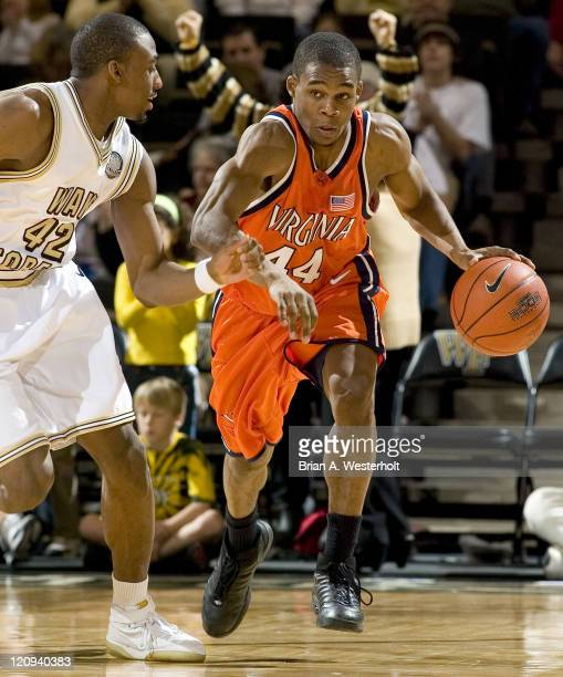 Virginia's Sean Singletary dribbles the ball past Wake Forest's L.D. Williams during the second half of play at the LJVM Coliseum in Winston-Salem,...