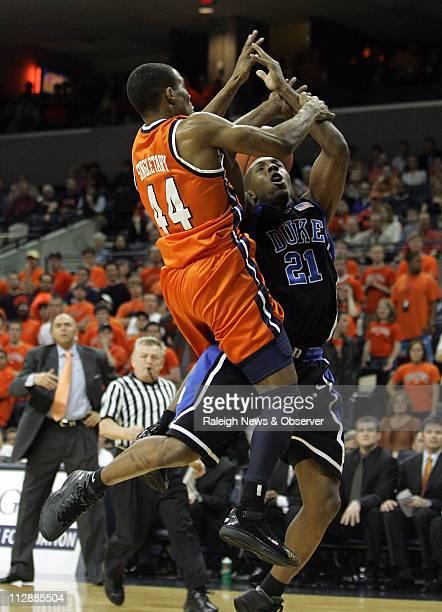 Virginia's Sean Singletary fouls Duke's DeMarcus Nelson during the first half at John Paul Jones Arena in Charlottesville Virginia on Wednesday March...