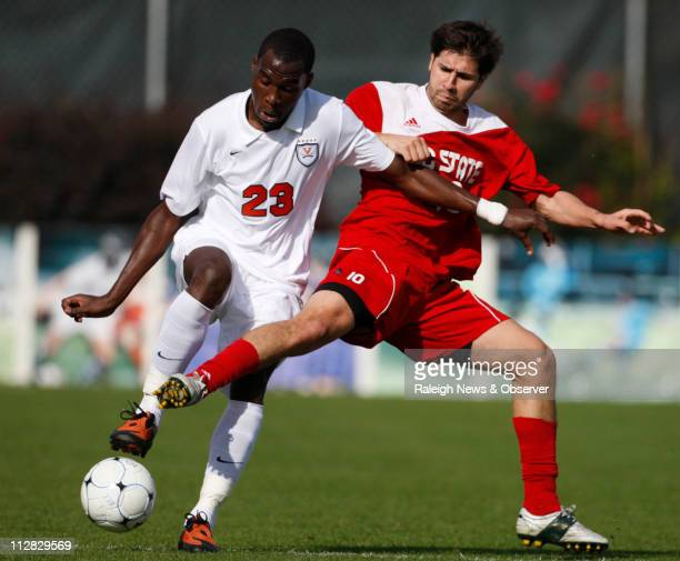 Virginia's Tony Tchani left and NC State's Alan Sanchez battle for the ball during the ACC Men's Soccer Championship game at WakeMed Soccer Park in...