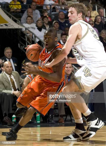 Virginia's Will Harris tries to drive the baseline past Wake Forest's Kyle Visser during second half action at the LJVM Coliseum in Winston-Salem,...