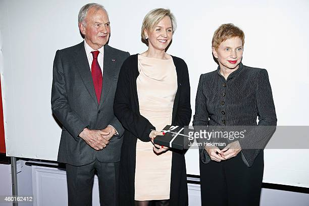 Virginie Calmels is pictured with Claude Bebear and Laurence Parisot after being awarded during the 'Prix De La Femme D'Influence 2014' Ceremony At...