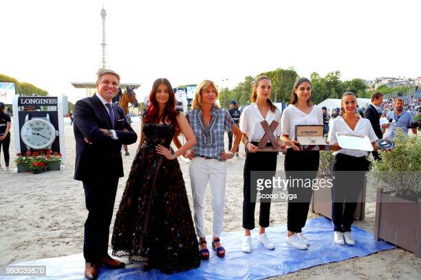 Virginie Couperie Eiffel Aishwarya Rai and Juan Carlos Capelli the Longines Eiffel Challenge at Champ de Mars on July 6 2018 in Paris France