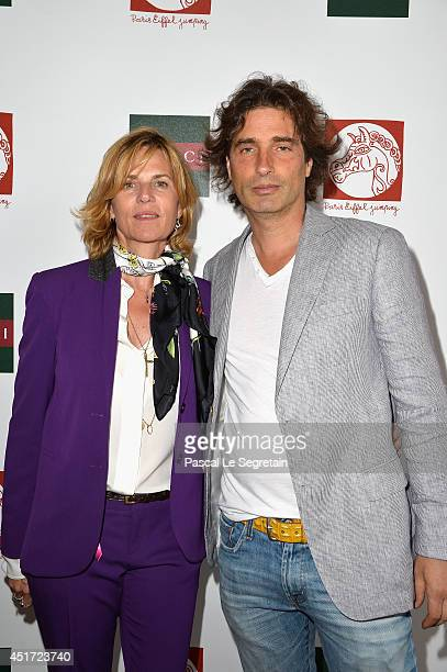 Virginie CouperieEiffel and Sculptor Richard Orlinski attend the Paris Eiffel Jumping presented by Gucci at ChampdeMars on July 5 2014 in Paris France