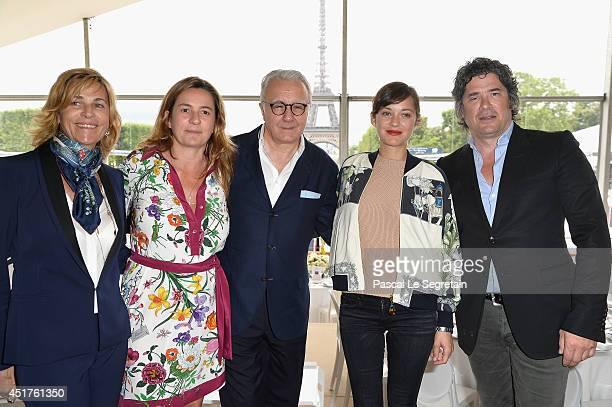 Virginie CouperieEiffel Coco Couperie Eiffel Alain Ducasse Marion Cotillard and Christophe Bonnat attend the Paris Eiffel Jumping presented by Gucci...