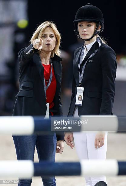 Virginie CouperieEiffel gives her instructions to Mathilde Pinault daughter of FrancoisHenri Pinault during day three of the Longines Paris Masters...