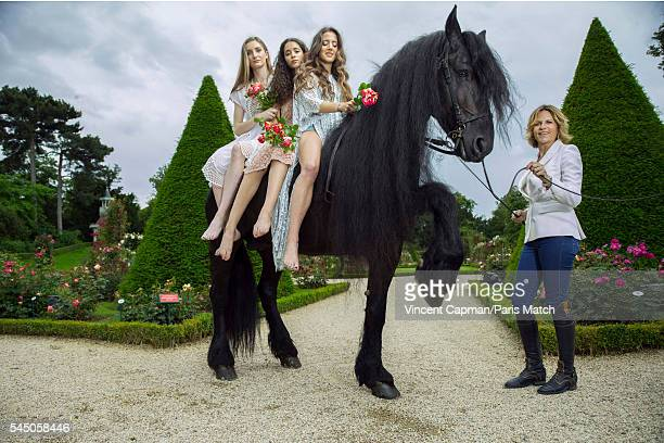 Virginie CouperieEiffel with and Mathilde Pinault Iman Perez and Flore Giraud are photographed for Paris Match with a horse called Le Frison in the...