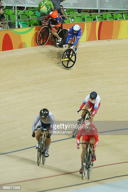 Virginie Cueff of France crashes out during the women's keirin first round on Day 8 of the Rio 2016 Olympic Games at the Rio Olympic Velodrome on...