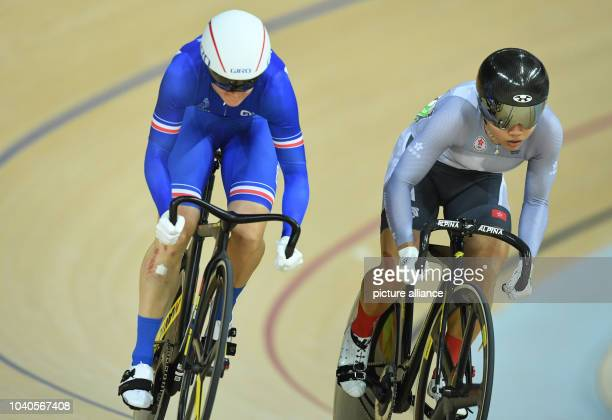 Virginie Cueff of France in action against Wai Sze Lee of Hong Kong during the Women's Sprint 1/16 Finals of the Rio 2016 Olympic Games Track Cycling...