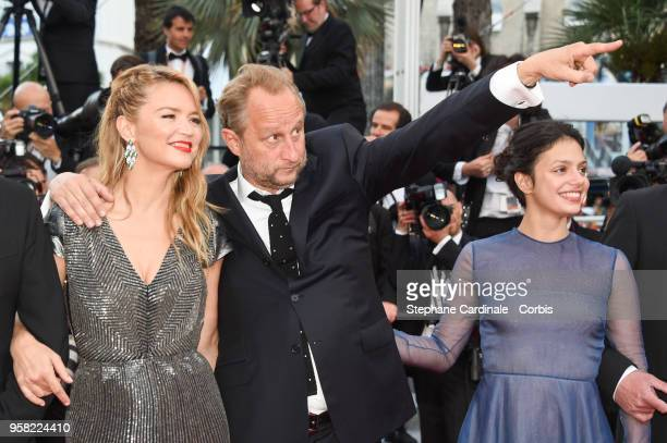 Virginie Efira Benoit Poelvoorde and Noee Abita attends the 'Sink Or Swim ' Photocall during the 71st annual Cannes Film Festival at Palais des...
