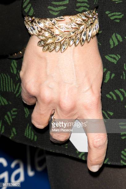 Virginie Guilhaume bracelet detail attends the 'Heroes for Imagine' host by Kamel Mennour benefit auction at L'Institut Imagine on February 12 2018...