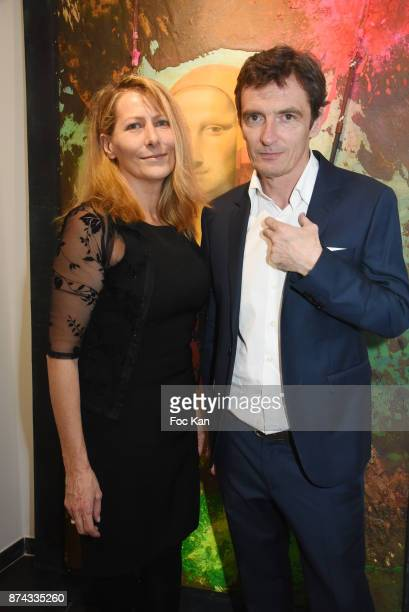 Virginie Guillaume and Denis Westhoff attend 'La Femme dans Le Siecle' Exhibition and Award Ceremony Cocktail at Galerie FRM on November 14 2017 in...