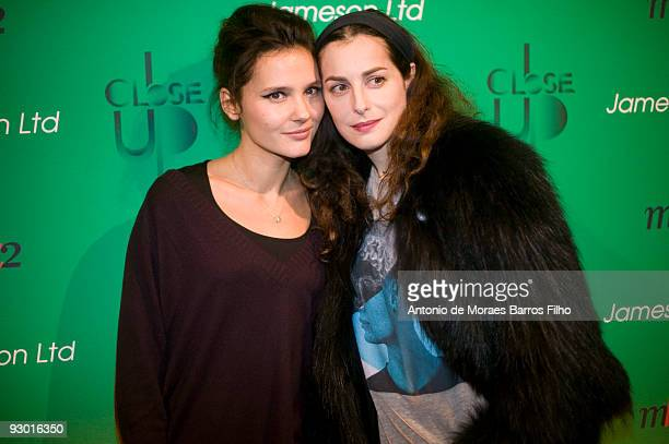 Virginie Ledoyen and Amira Casar attend the Close Up Festival 2nd Edition Take it Irish Party at Mk2 Bibliotheque on November 12 2009 in Paris France