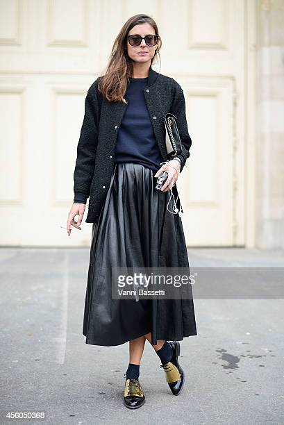 Virginie Muys poses wearing a Julien David jacket Black denim skirt and Cline shoes on September 24 2014 in Paris France