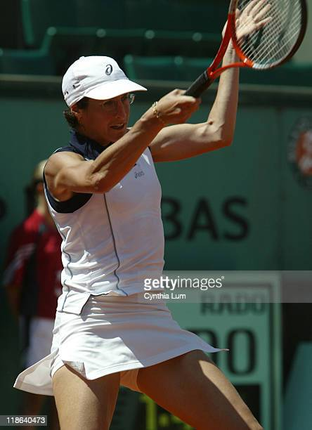 Virginie Razzano hits a forehand Virginie Razzano is defeated by Lindsay Davenport 75 46 64 in the third round of the French Open at Roland Garros