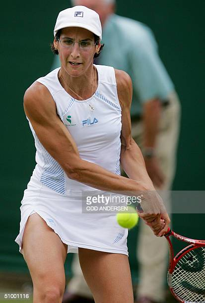 Virginie Razzano of France hits a backhand to Rita Grande of Italy during the 118th Wimbledon Tennis Championships in Wimbledon London 25 June 2004...