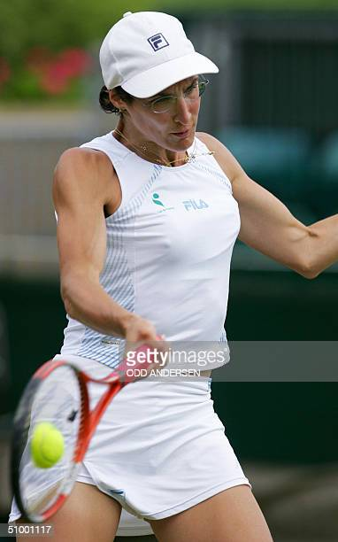 Virginie Razzano of France hits a forehand to Rita Grande of Italy during the 118th Wimbledon Tennis Championships in Wimbledon London 25 June 2004...