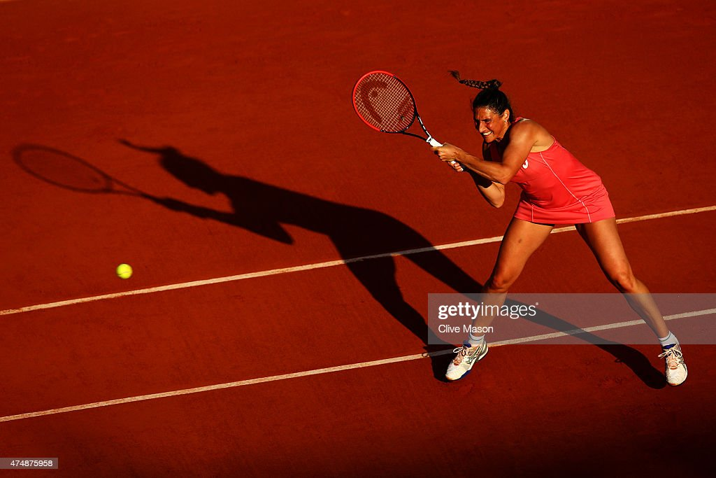 Virginie Razzano of France returns a shot during her women's singles match against Carla Suarez Navarro of Spain during day four of the 2015 French Open at Roland Garros on May 27, 2015 in Paris, France.