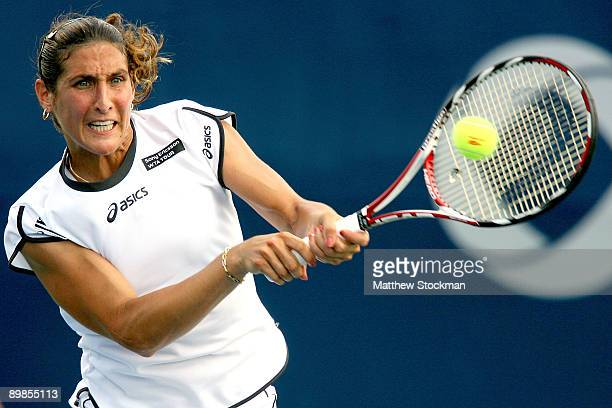 Virginie Razzano of France returns a shot to Ekaterina Makarova of Russia during the Rogers Cup at the Rexall Center on August 18 in Toronto Ontario...