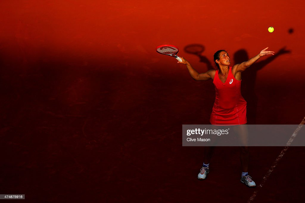 Virginie Razzano of France serves during her women's singles match against Carla Suarez Navarro of Spain during day four of the 2015 French Open at Roland Garros on May 27, 2015 in Paris, France.