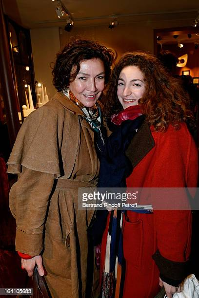 Virginie Thevenet and Anna Klossowski de Rola attend Vincent Darre Exhibition opening at Galerie Pierre Passebon on March 19 2013 in Paris France