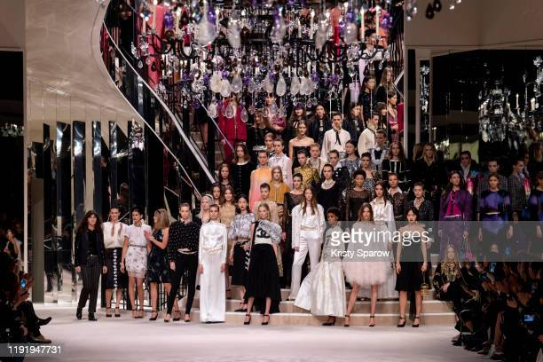 Virginie Viard acknowledges the audience during the finale of the Chanel Metiers d'Art 2019-2020 show with models at Le Grand Palais on December 04,...