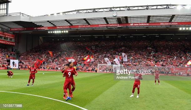 Virigl van Dijk and Roberto Firmino of Liverpool embrace before the Premier League match between Liverpool FC and West Ham United at Anfield on...