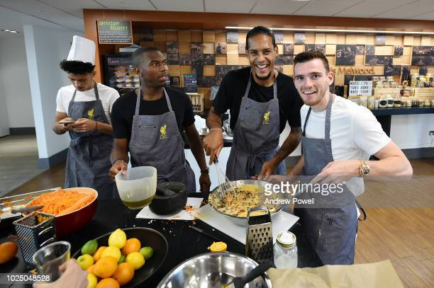 Virigl van Dijk Curtis Jones Andy Robertson and Daniel Sturridge of Liverpool baking a cake as a forfeit for losing a tournament during training at...