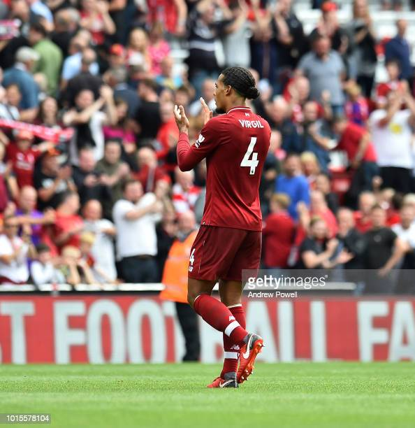 Virigl van Dijk of Liverpool shows his appreciation to the fans at the end of the Premier League match between Liverpool FC and West Ham United at...