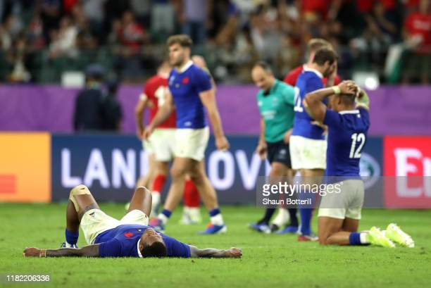 Virimi Vakatawa and Gael Fickou of France look dejected after defeat during the Rugby World Cup 2019 Quarter Final match between Wales and France at...