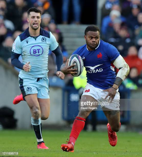 Virimi Vakatawa of France breaks away from Adam Hastings during the 2020 Guinness Six Nations match between Scotland and France at Murrayfield on...