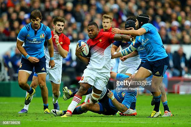 Virimi Vakatawa of France breaks free from a tackle by Gonzalo Garcia of Italy during the RBS Six Nations match between France and Italy at Stade de...
