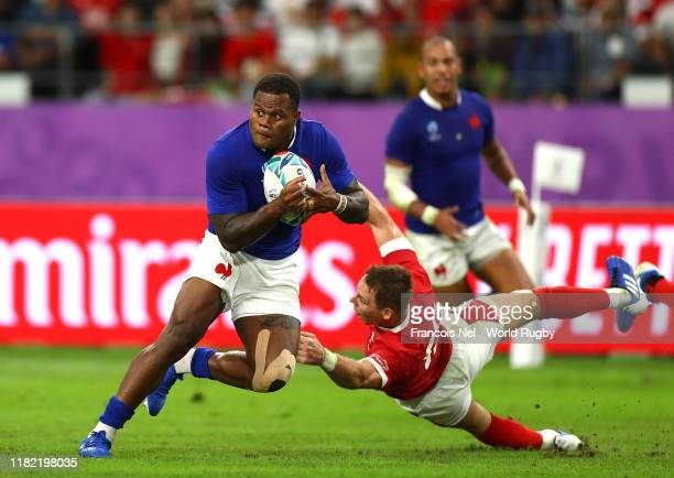 Virimi Vakatawa of France breaks past Liam Williams of Wales prior to scoring his sides third try during the Rugby World Cup 2019 Quarter Final match...